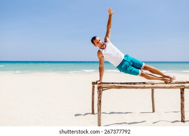 fitness handsome man work out on the beach with sea view