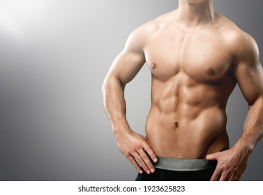 Fitness handsome sport male model posing in studio