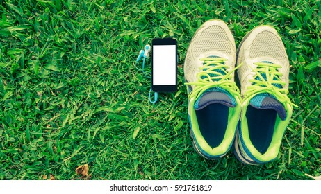 Fitness, healthy and active lifestyles Concept, sport shoes, smart phone and head phone. Top view with copy space for text.