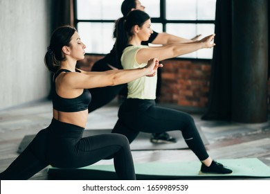 Fitness, healthy lifestyle. Group of women working out at the gym. People exercising, keeping body in perfect shape