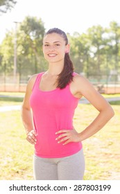 Fitness Healthy Lifestyle Smiling Female posing outdoor.