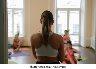 Fitness instructor enters the gym