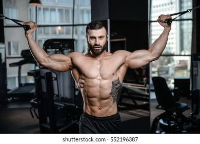 Fitness instructor handsome man in the gym gain muscle healthcare lifestyle sexy caucasian man bodybuilder work out naked body with tattoo