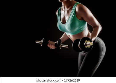 Fitness instructor working out with dumbbells