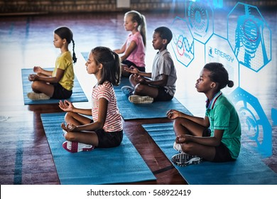 Fitness interface against school kids meditating during yoga class