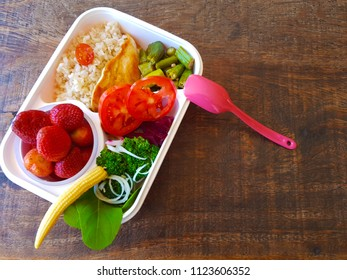 Fitness kettle, healthy food, brown rice, greens, vegetables and fruits.