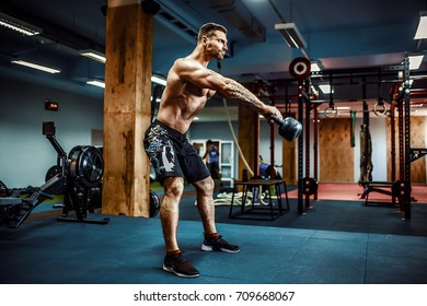 Fitness Kettlebells swing exercise bearded man workout at gym