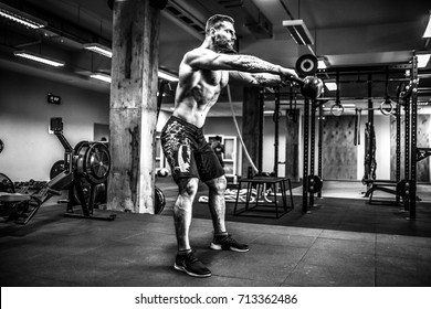 Fitness Kettlebells swing exercise bearded man workout at functional gym