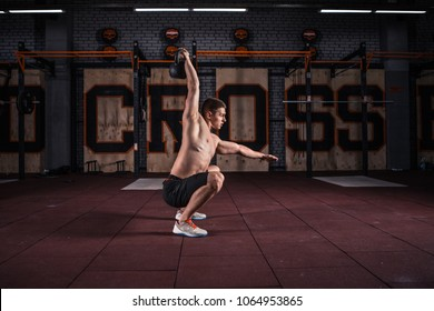 Fitness Kettlebells swing exercise man workout at  gym. Crossfit training
