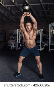 Fitness Kettlebells swing exercise man workout at gym