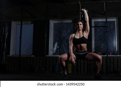 fitness Kettlebells swing exercise woman workout at gym