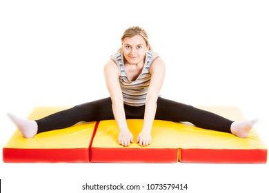 fitness lass doing stretching on a mat
