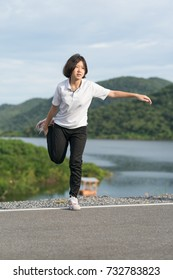 Fitness and lifestyle concept - Young asian woman short hair doing exercising outdoor