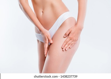 Fitness liposuction fat burning concept. Cropped close-up of nice sportive adorable belly legs skinny girl touching hips smooth shine soft skin healthy lifestyle isolated over light gray background