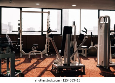 Fitness machines in fitness room at the evening. Modern gym interior with equipment.fitness center interior