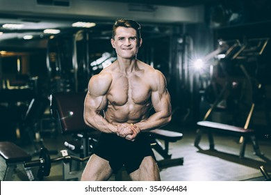 Fitness male at the gym all the muscles straining and screaming with the effort