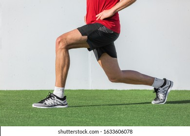 Fitness man doing legs exercise lunges workout for glute and leg muscle training core muscles, balance, cardio and stability. Active sport athlete doing front forward one leg step lunge exercise.