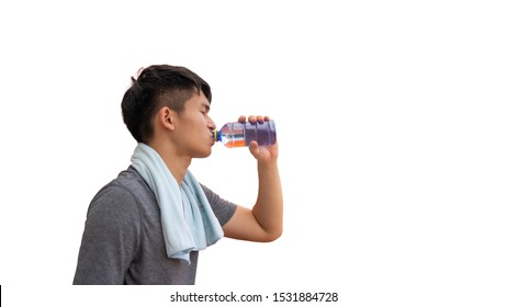 Fitness man drinking water from bottle splashing water after running workout on white background