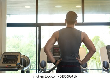 Fitness man exercise on training equipmet,warm up body in gym,fitness club,cardio working,perpare for runnig on treadmill.Healthy lifestyle.