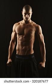Fitness man, low key lighting