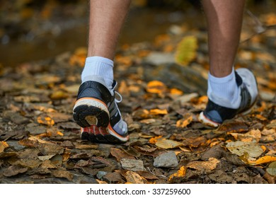 fitness man walking cross in autumn forest