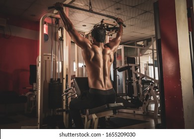 Fitness man working out lat pulldown training at gym