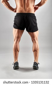 Fitness model displaying strong calves and legs
