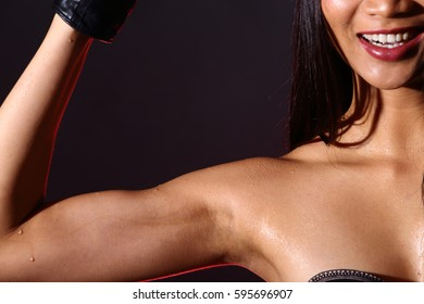 Fitness Model Lady woman sweaty sporty open shoulder after heavy exercise, weight loss concept, red back light dark studio background
