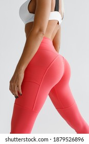 Fitness model in leggings with beautiful buttocks