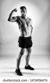 Fitness model portrait on gray background, studio shot