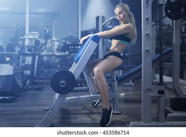 Fitness model posing in the gym