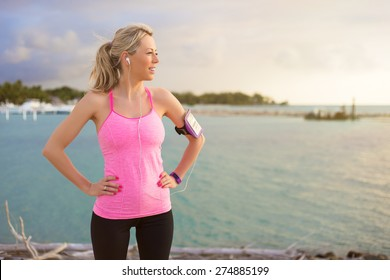 Fitness model standing outdoors in early morning