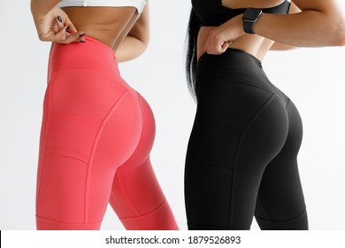 Fitness models in leggings with beautiful buttocks