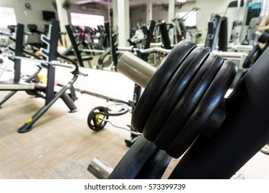 Fitness modern gym interior with equipment, Machines at the gym room