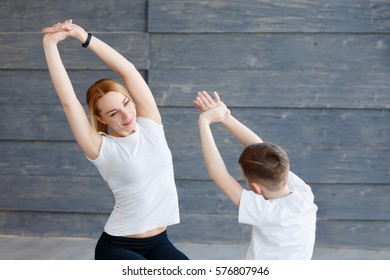 Fitness mother with her 9 years old son. Sports mom with kid doing morning work-out at home. Mum and child do the exercises together, healthy family lifestyle concept