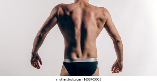 fitness muscled man back. Male back.