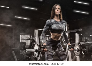 Fitness muscular body, strong hand on dark background Pumping up muscles