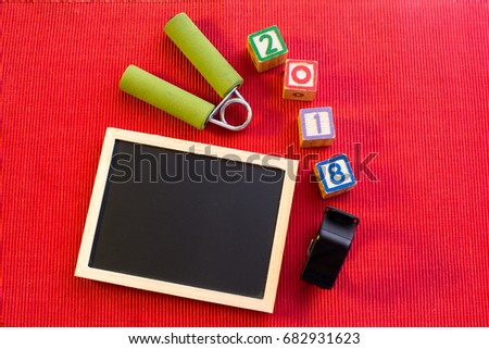 fitness new year 2018 get healthy concept empty black board for writing motivational