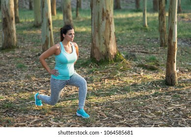 Fitness pregnant woman doing lunges for strengthen pelvic floor muscles and legs. Healthy pregnancy exercise.