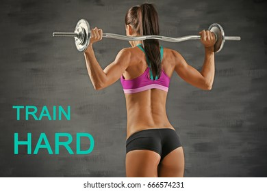 Fitness quotes. Text TRAIN HARD and young woman training with barbell on grey background