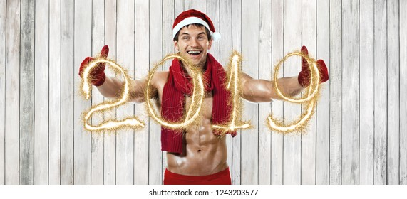 fitness sexy Santa Claus in red woollen scarf, 2019 concept