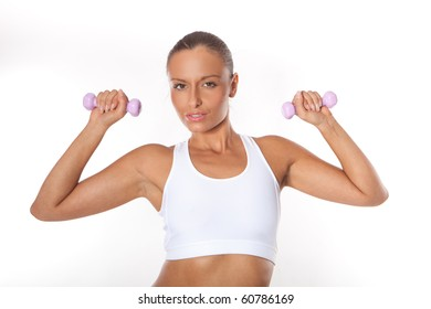Fitness sexy woman working out with free weights isolated on white