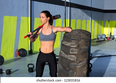 Fitness sledge hammer woman workout at gym relaxed after exercise