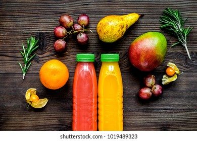 fitness smoothie in plastic bottle on wooden table top view mock