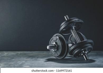 Fitness Sport Background eith black dumbbells