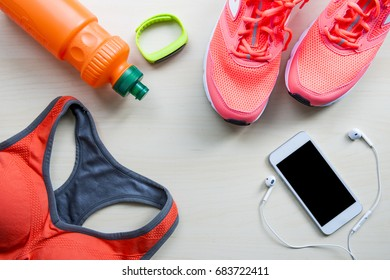 Fitness and sport equipment wooden background