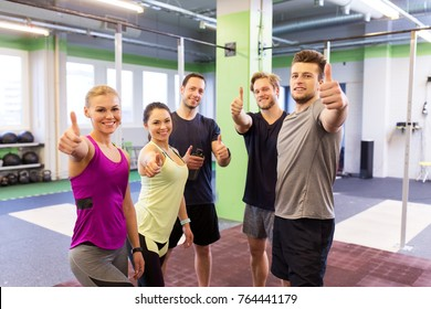 fitness, sport, exercising and healthy lifestyle concept - group of happy people in gym showing thumbs up