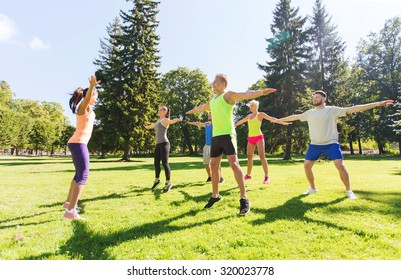 fitness, sport, friendship and healthy lifestyle concept - group of happy teenage friends exercising at boot camp