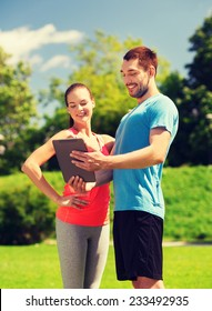 fitness, sport, friendship, technology and lifestyle concept - smiling couple with tablet pc computer outdoors