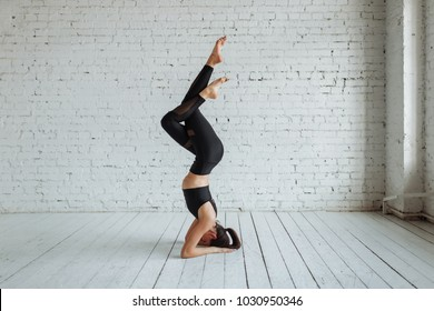 Fitness sport girl fashion sports yoga fitness doing exercises in the gym, the concept of a healthy lifestyle